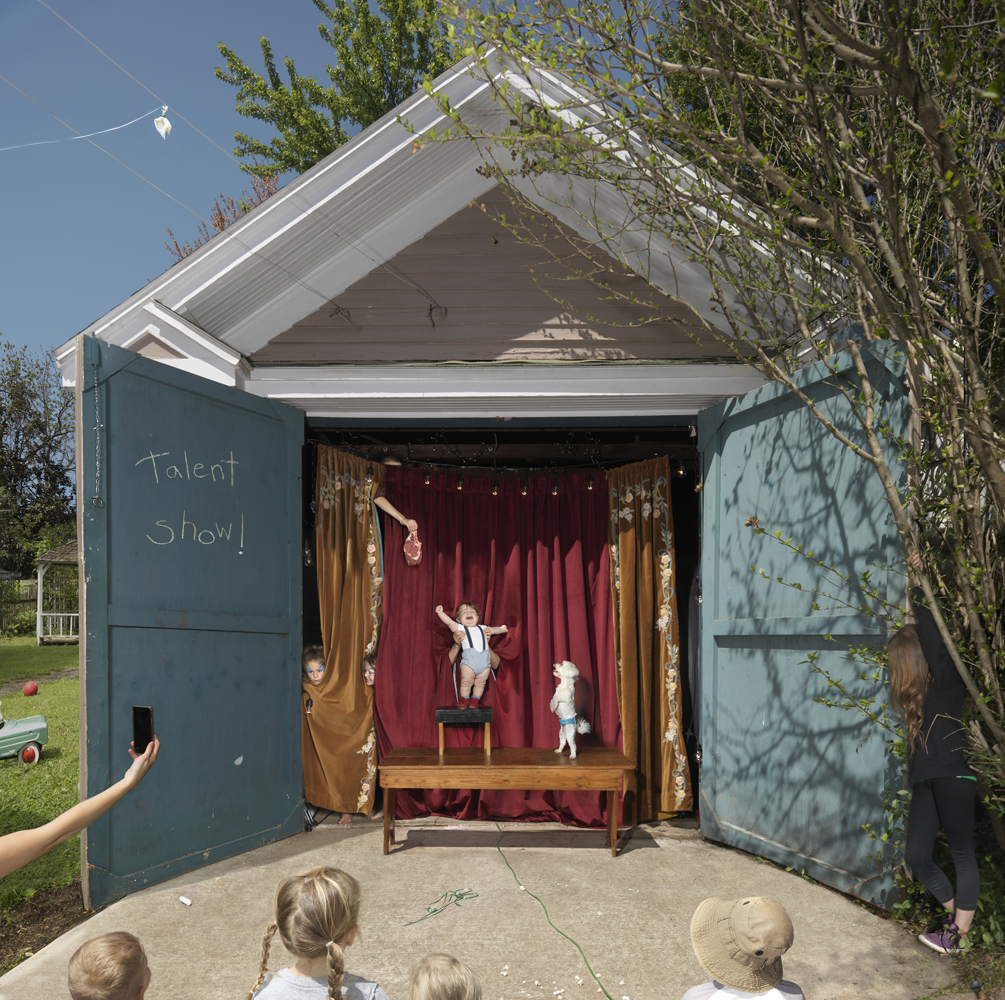 Julie Blackmon, Talent Show, 2019, archival pigment print, 22×22″, 32×32″, 40×40″, editions of 10, 7, 5, price on request