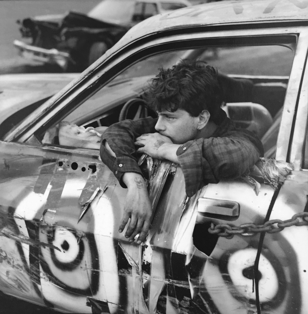 Danny Lyon, Demo Driver, The Wall Stadium, 1988/1993, gelatin silver print, 7 x 7 (image size) / 8 x 10 (paper size) inches, signed and stamped by artist, $2000.