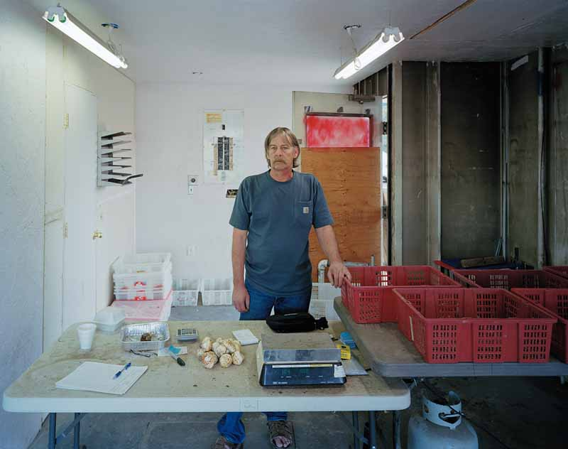 Eirik Johnson, Leo buying matsutake mushrooms in Stubby's Fuel Stop, Chemult, Oregon, 2011