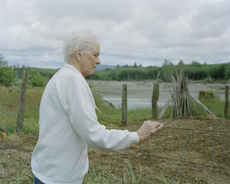 Eirik Johnson, Missy by her garden, lower Hoh River, Washington, 2007