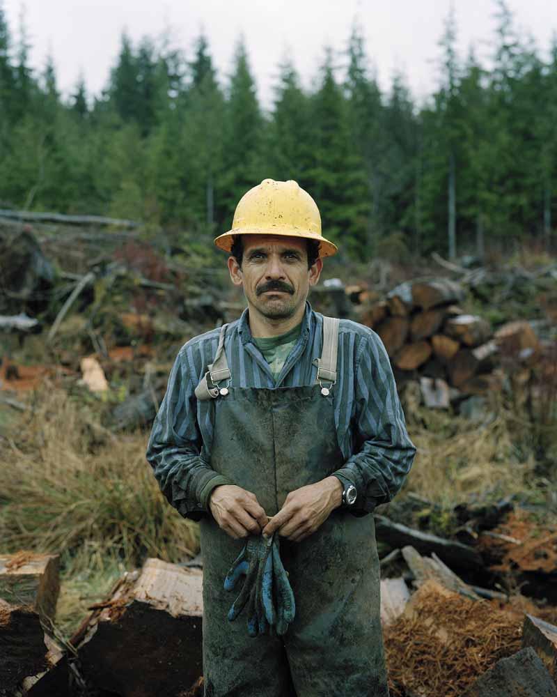 Eirik Johnson, Juan Valencia salvaging cedar shingle bolts, lower Hoh River, Washington, 2007