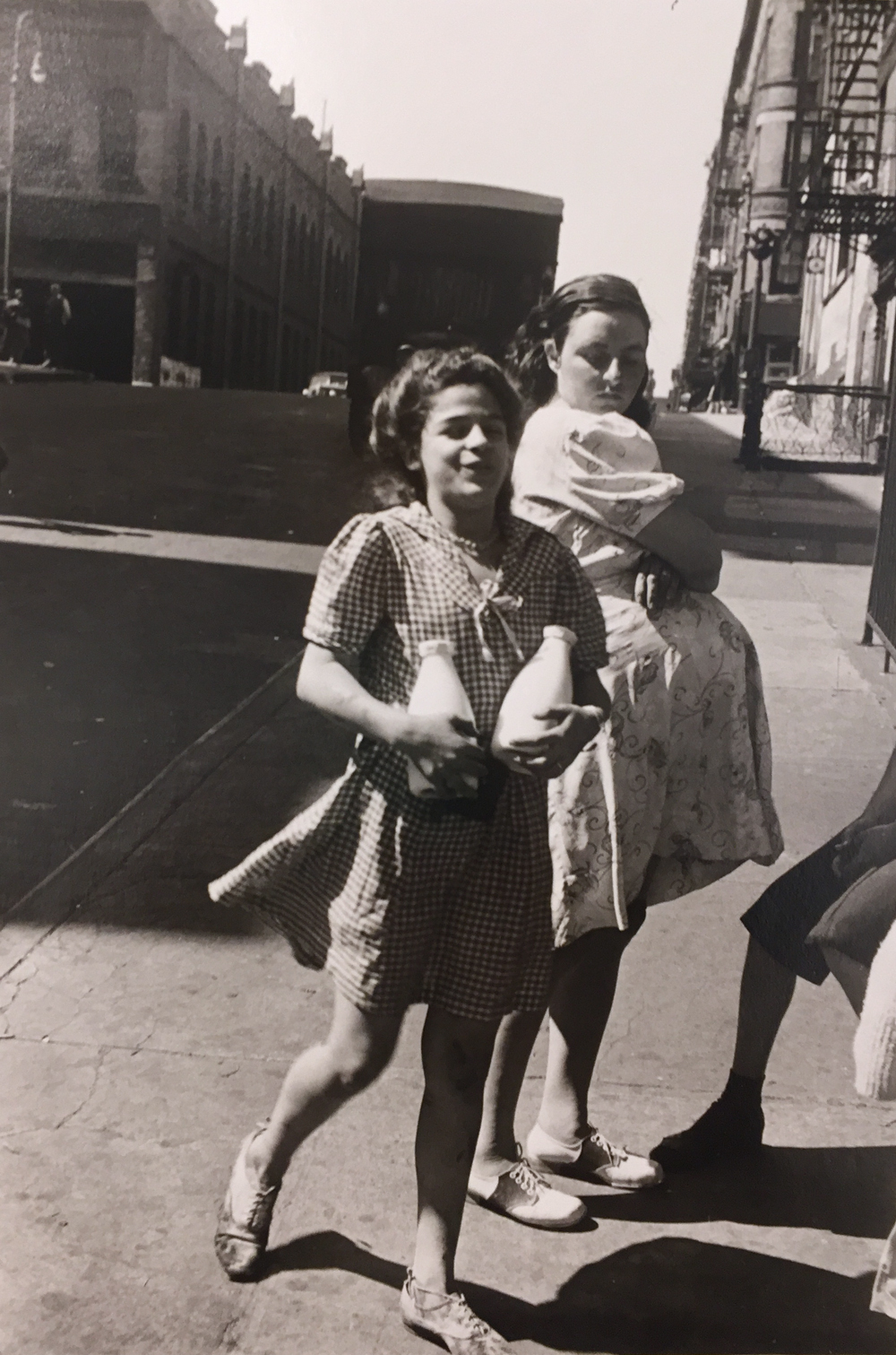 Helen Levitt, Untitled, 1945 (Girl with milk bottles), gelatin silver print, 14 x 11 inches, signed by artist, verso, price on request