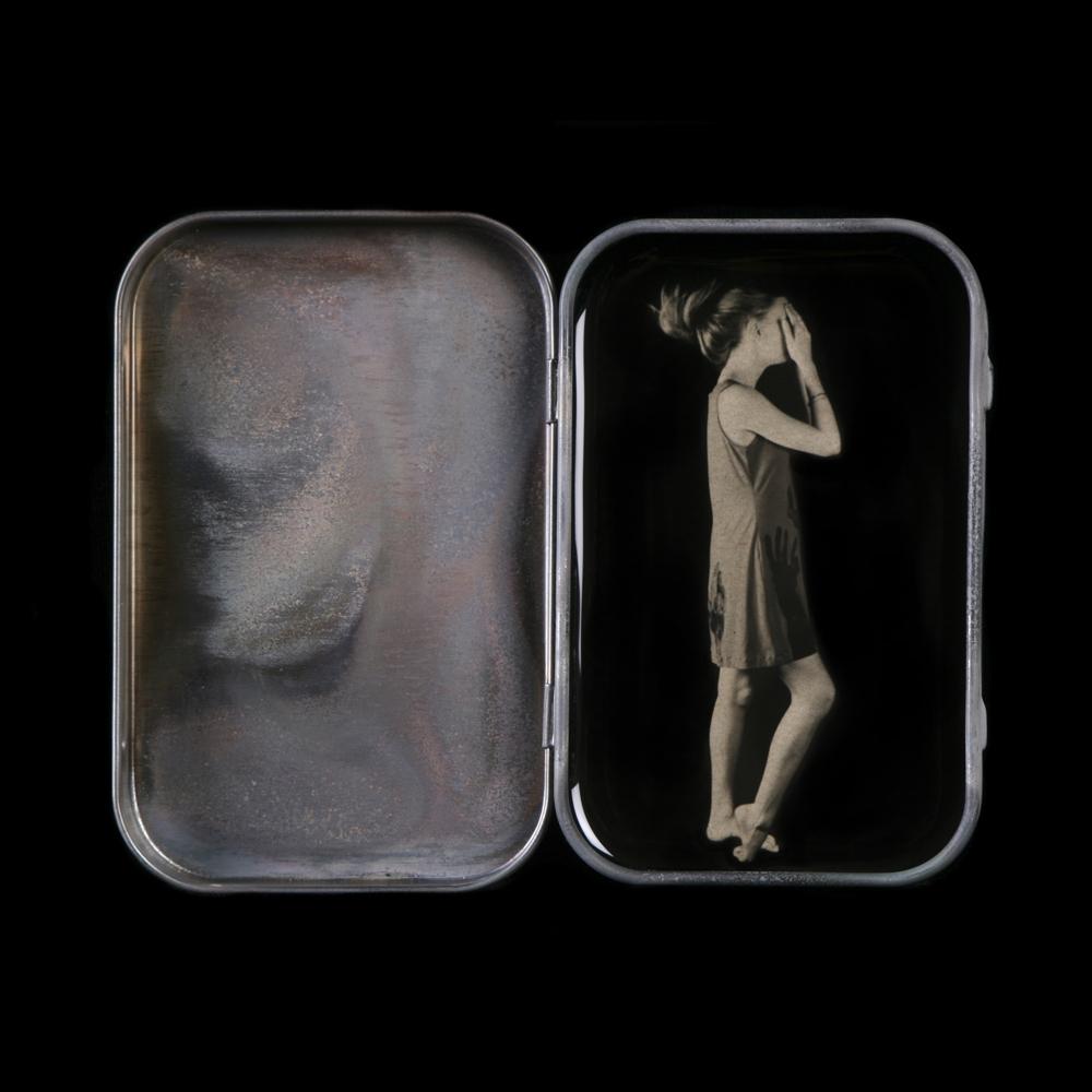 Heidi Kirkpatrick, Hide and Go Seek, 2014, tin, photolith film, resin, edition 1/5, 3.625 x 4.25 x .75 inches, $450.