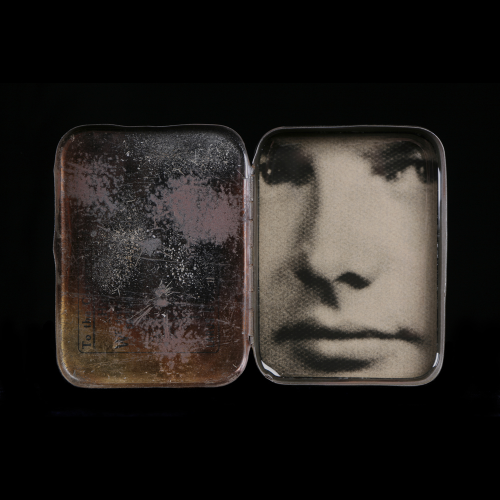 Heidi Kirkpatrick, Him, 2014, tin, photolith film, resin, edition of 5, 4.5 x 6.5 x 1 inches, $650.