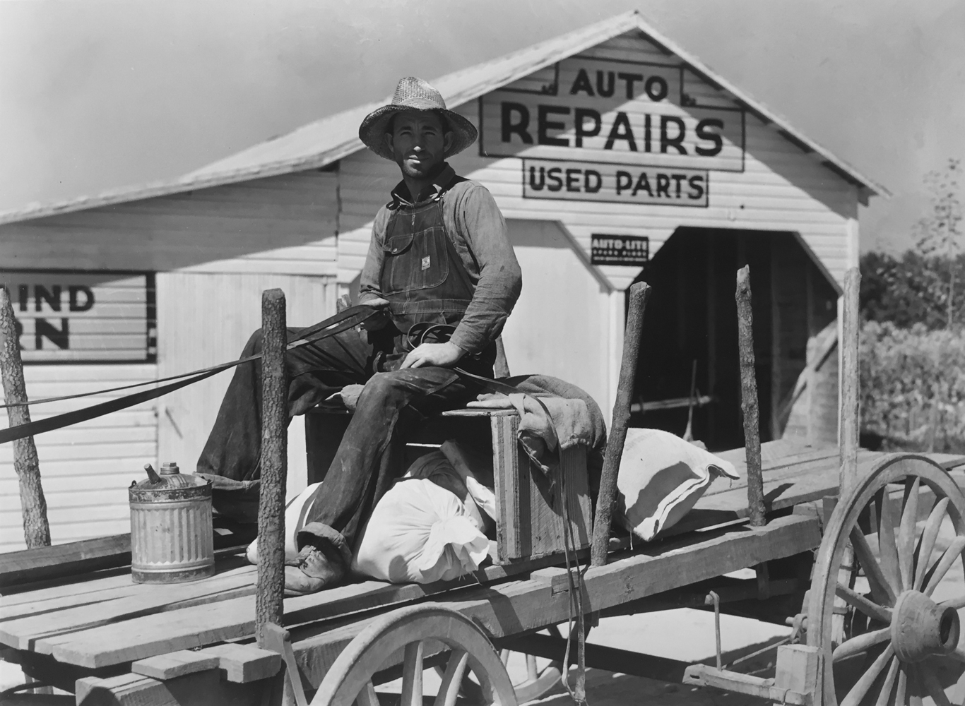 Marion Post Wolcott, Auto Repairs, Used Parts, Man in Wagon with Supplies, gelatin silver print, 11 x 14 inches, price on request