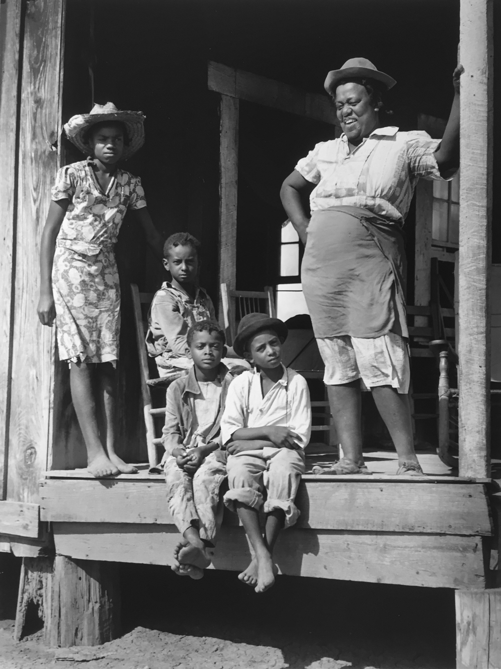 Marion Post Wolcott, Family on the porch of their home, Natchitoches, Louisiana, 1940, gelatin silver print, 14 x 11 inches, signed by the artist, $3000.