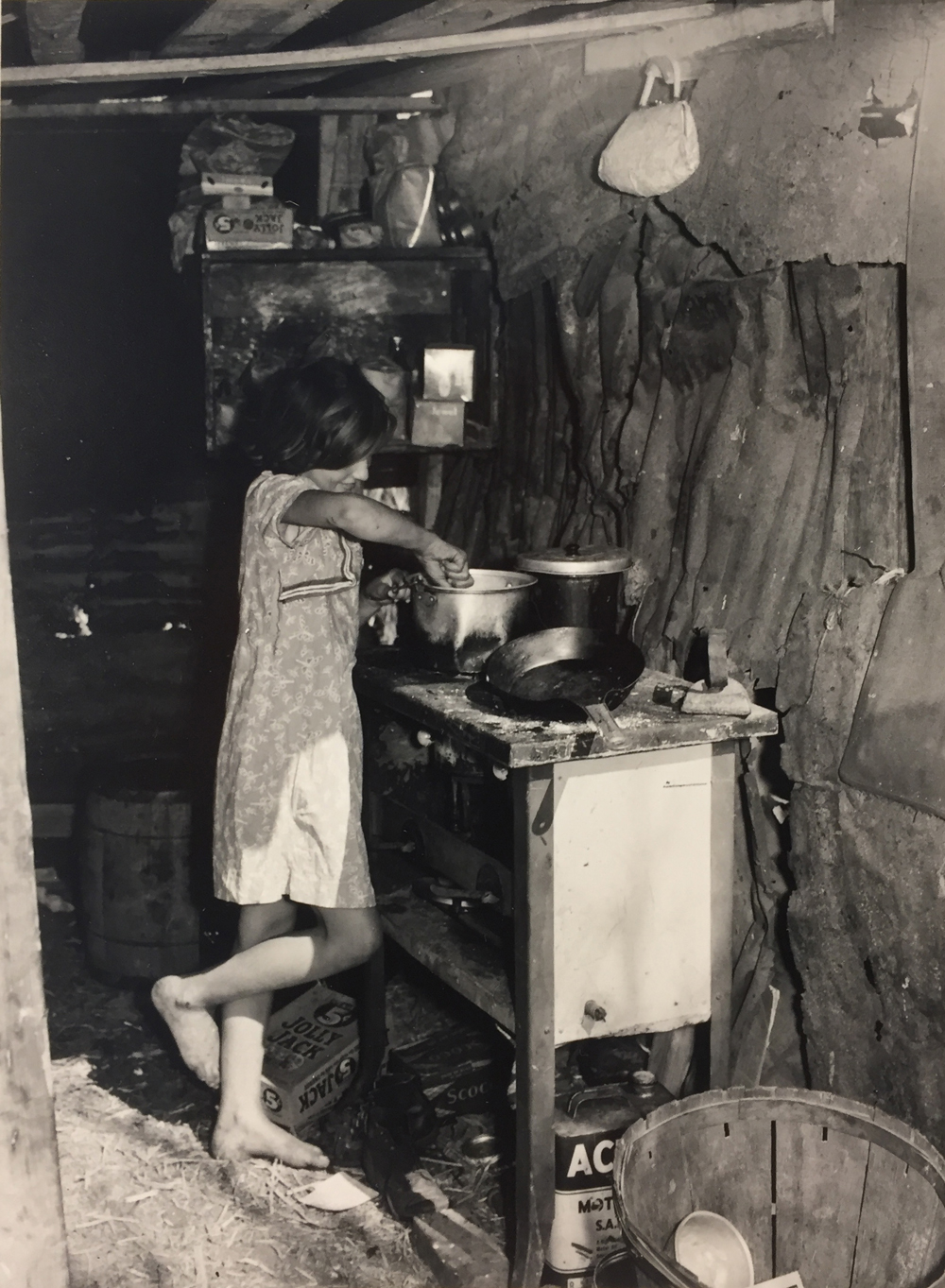 Marion Post Wolcott, Oldest child of migrant packing-house workers preparing supper. Her parents work during the day and sometimes until 2am. The children are left alone, Near Homestead, FL, 1939, gelatin silver print, 7 x 5 inches, price on request