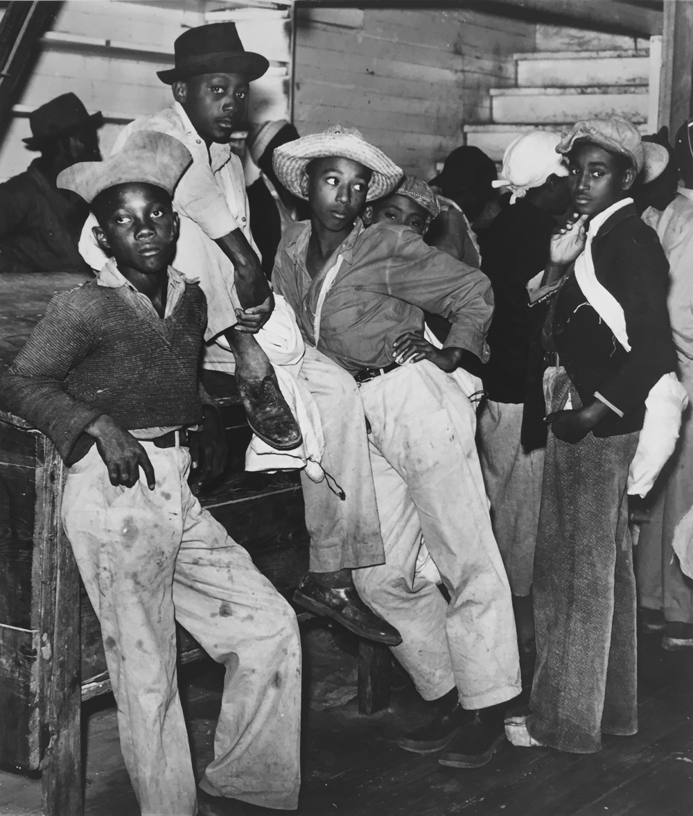 Marion Post Wolcott, Young men waiting to be paid for picking cotton, inside plantation store, Marcella Plantation, Milestone, Mississippi, 1939, gelatin silver print, 14 x 11 inches, price on request