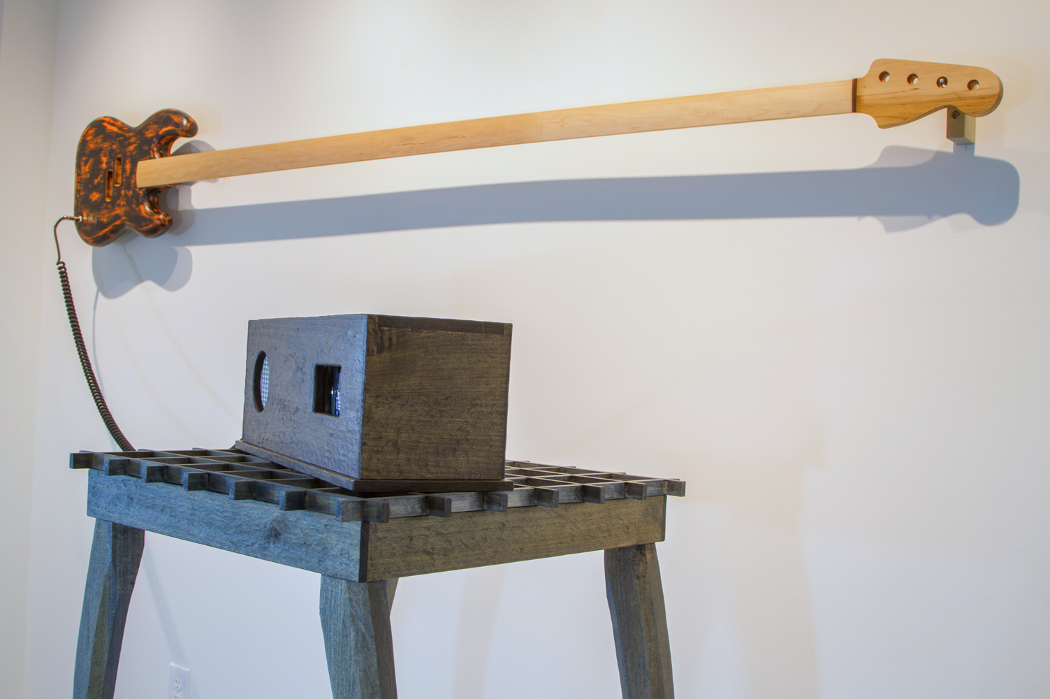 Matt Sellars, Put your ear to rails and listen for the hum, but for the chaos of man, 2017, maple , poplar, stain, audio + video installation, 116 x 67 x 34 inches, $6000.