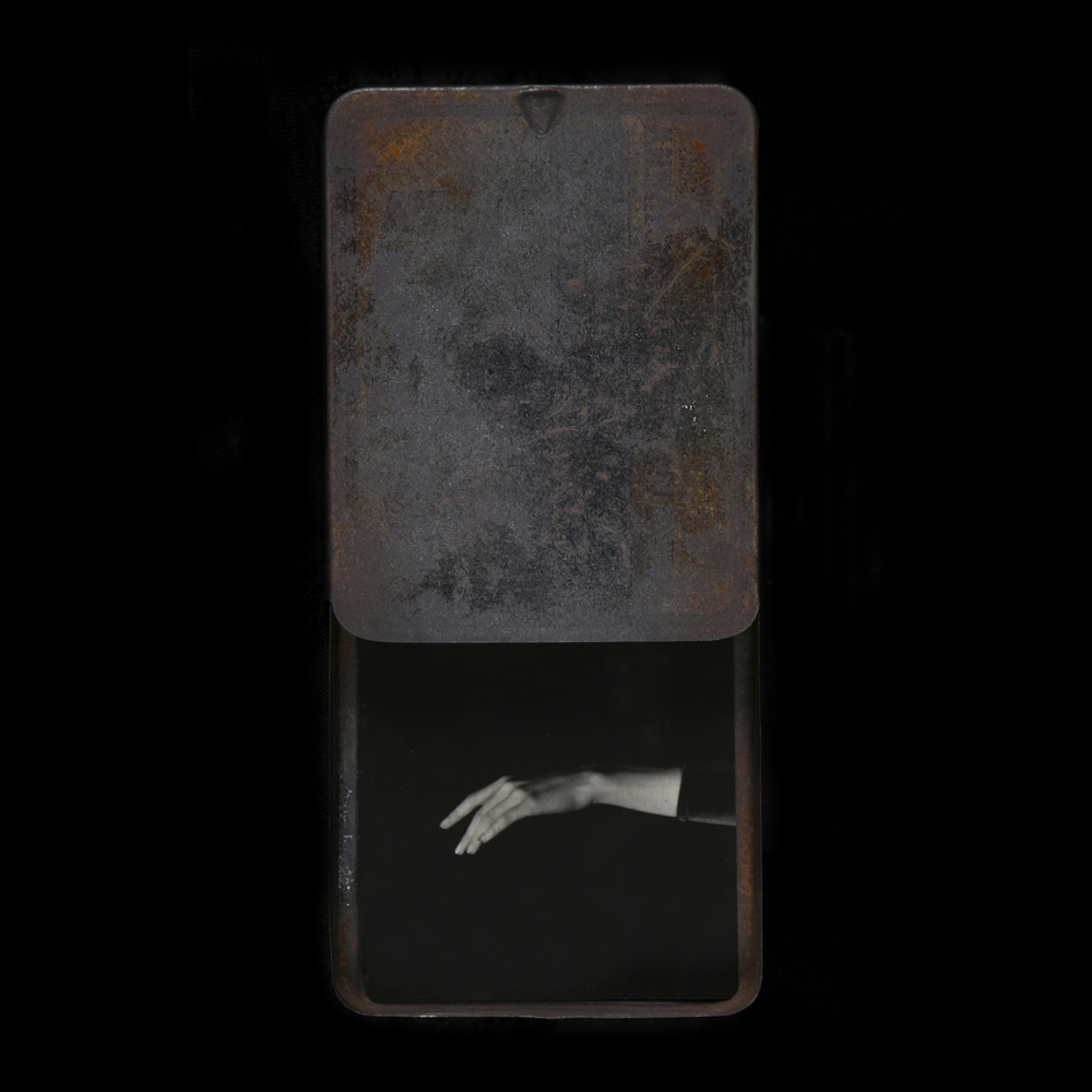 Heidi Kirkpatrick, She Gives Her Hand Freely, 2014, tin, photolith film, resin, edition 1/5, 5.75 x 2.75 x .5 inches, (SOLD)