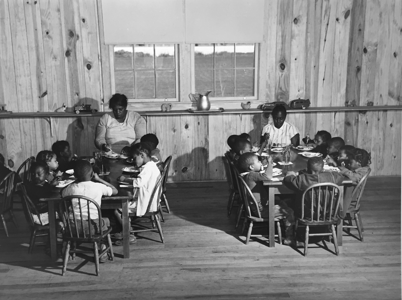 Marion Post Wolcott, Hot lunches for children of agricultural workers in day nursery of Okeechobee Migratory Labor Camp, Belle Glade, FL, 1941, gelatin silver print, 11 x 14 inches, signed by artist, $3000.