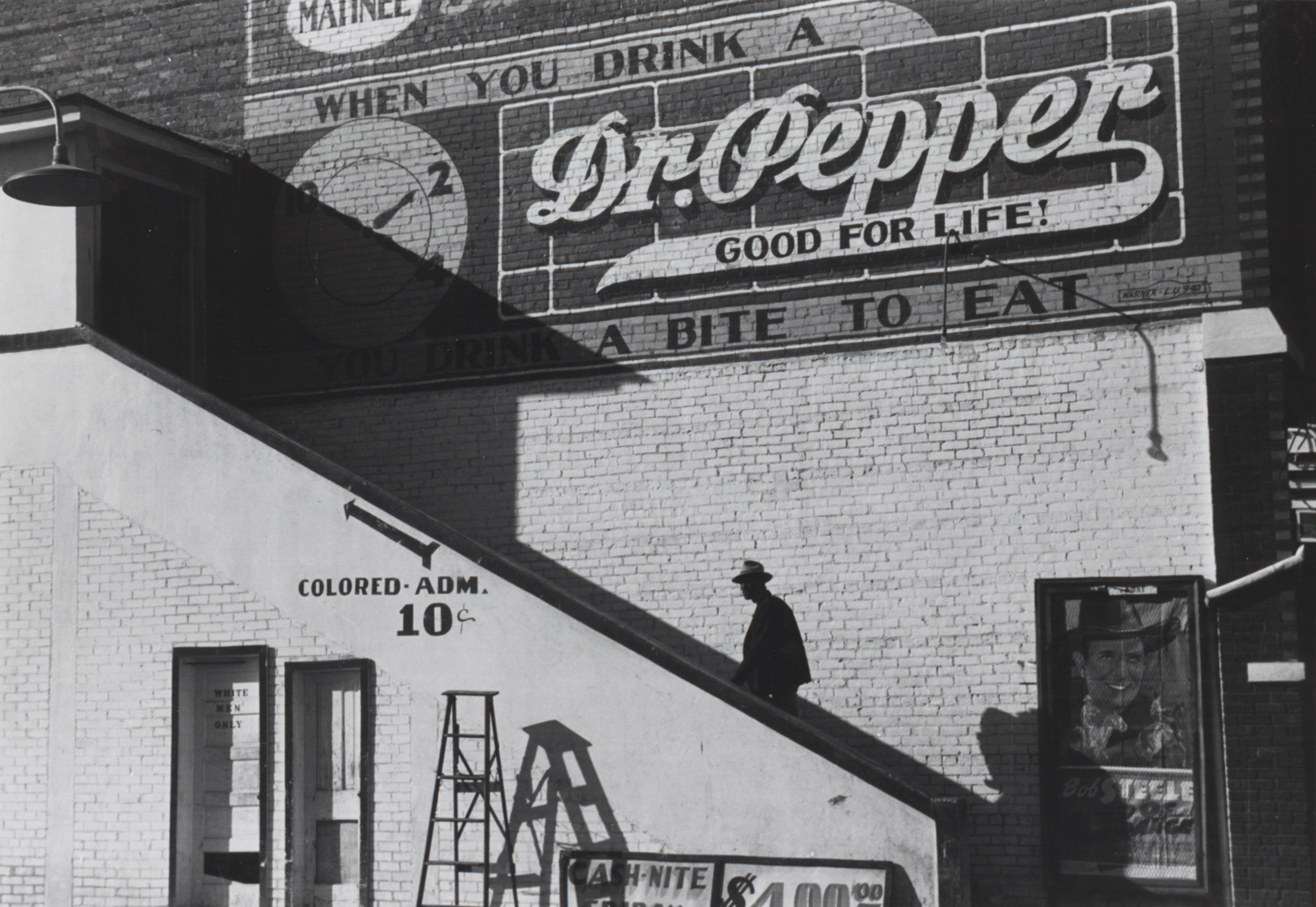 Marion Post Wolcott, Man entering theater, Belonzi, Mississippi, 1939, gelatin silver print, 11 x 14 inches, price on request