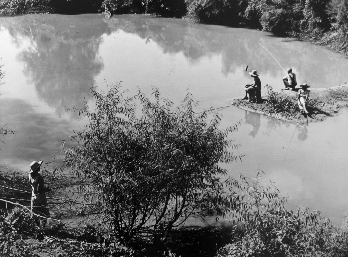 Marion Post Wolcott, Fishing in creek near cotton plantations outside Belzoni. Mississippi Delta, Mississippi, 1939, gelatin silver print, signed, 11 x 14 inches, $2500.