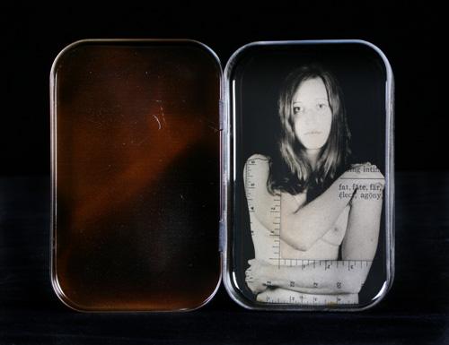 Heidi Kirkpatrick, Measured Up, 2008, tin, photolith film, resin, 3.25 x 4.125 x .75 inches, $450.