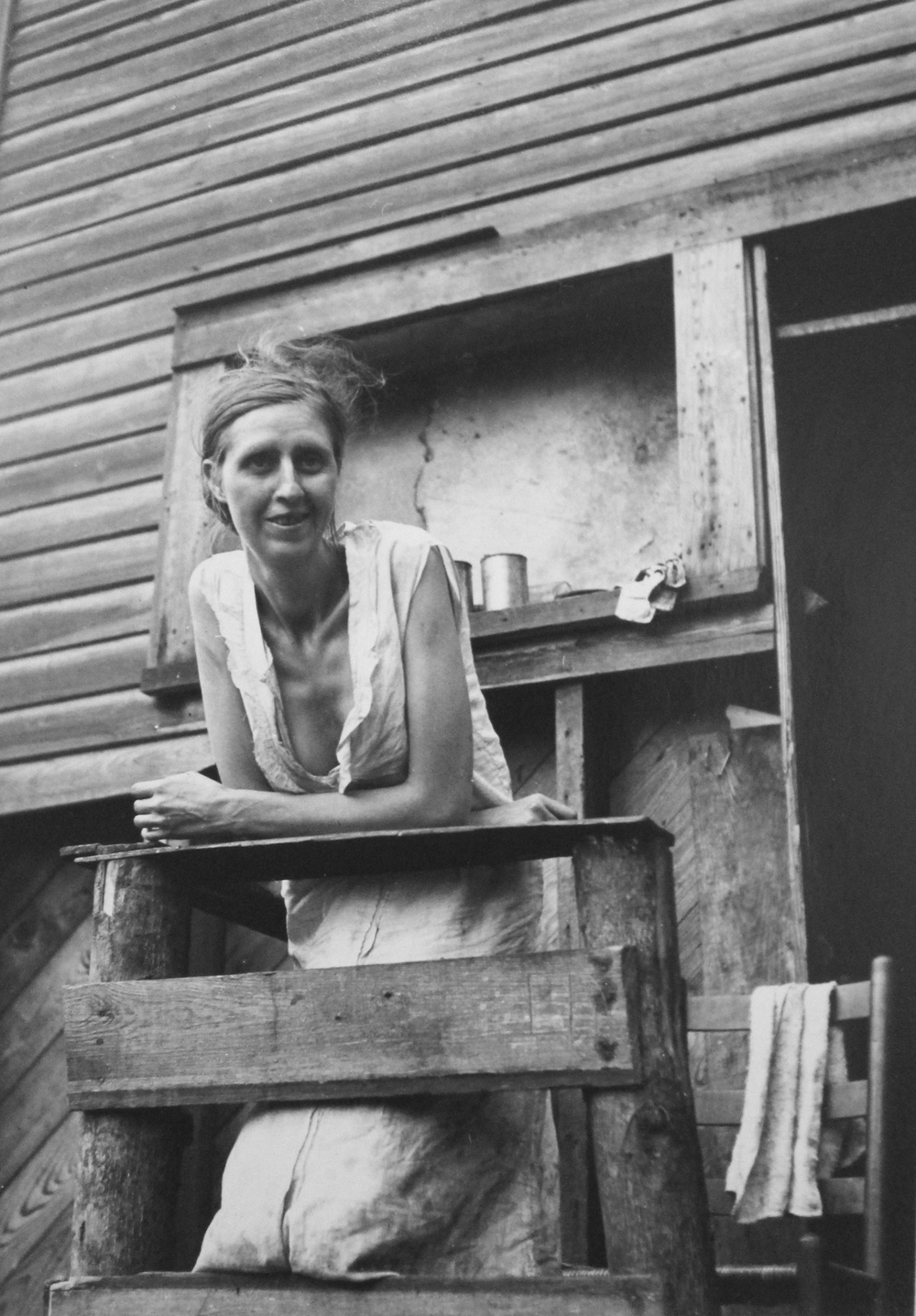 Marion Post Wolcott, Miners wife on the porch of their home, an abandoned company store, Pursglove, West Virginia, 1938 gelatin silver print, signed by Lee Wolcott, 5 x 7 inches