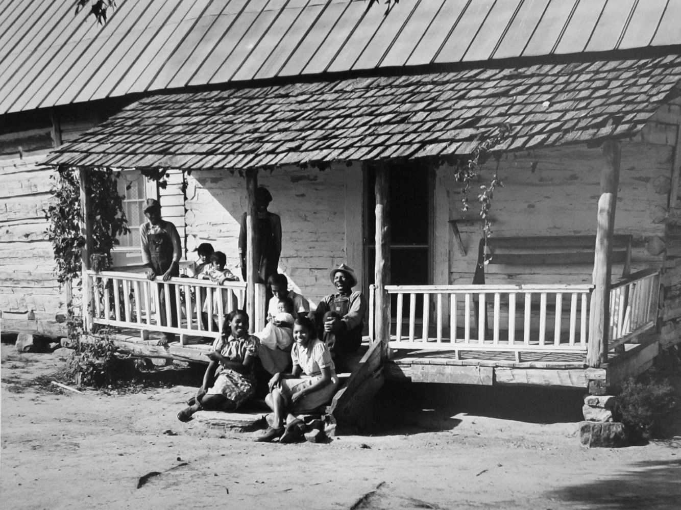 Marion Post Wolcott, A Negro tenant family on porch of their home. They are Farm Security Administration borrowers. Casewell County, North Carolina, 1940, gelatin silver print, signed, 11 x 14 inches