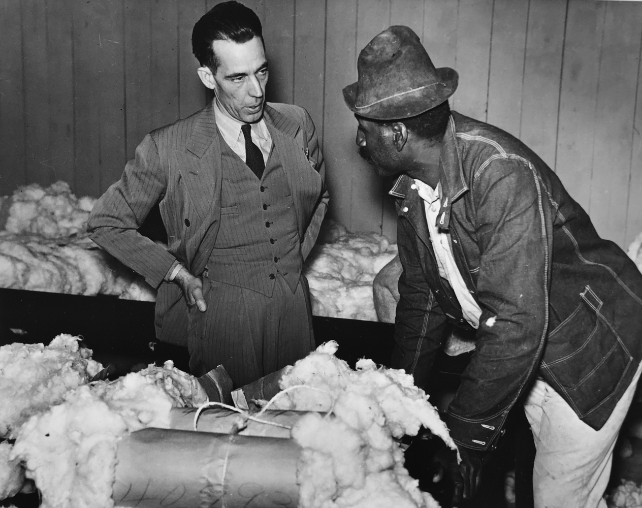 Marion Post Wolcott, Tenant farmer brings his cotton sample to buyer/broker to discuss price, Clarksdale, MS, 1939, gelatin silver print, 11 x 14 inches, signed by artist, $3000.
