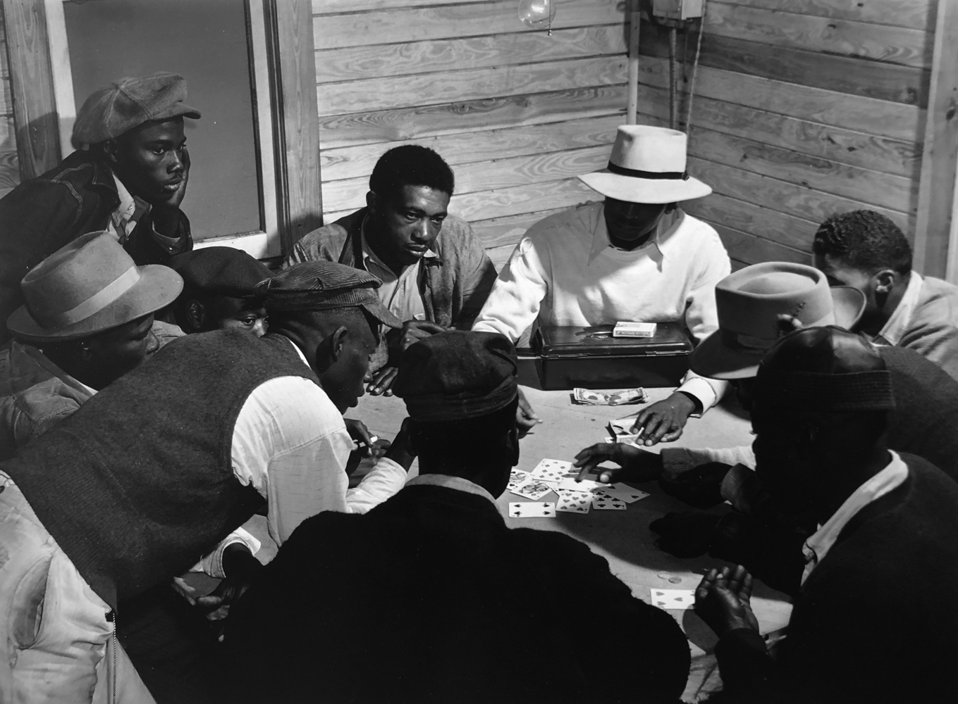 Marion Post Wolcott, Gambling in a Juke Joint, A Skin Game, near Moore Hanen, Florida, 1941, gelatin silver print, 11 x 14 inches, signed by the artist, $3000.