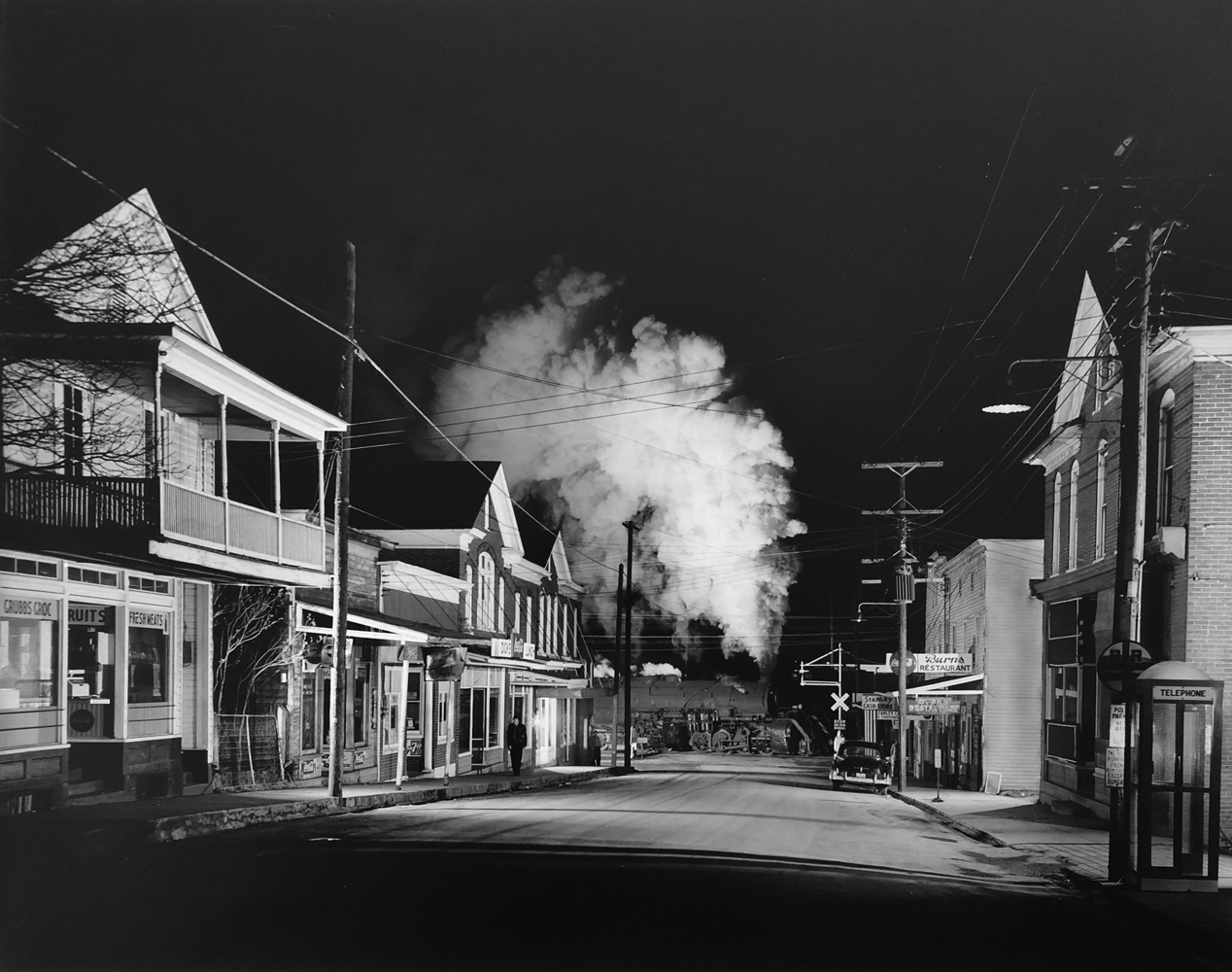 O. Winston Link, Policeman Weldon Painter Patrols the Main Street, Stanley, Virginia, 1956, gelatin silver print, 15.25 x 19.25 inches, signed by artist, price on request